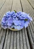Bouquet of hydrangea on rustic wood Stock Photo