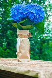 Bouquet of hydrangeas on the table in the garden on a rainy. Cloudy day Royalty Free Stock Photo