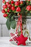 Bouquet of hypericum plants twigs with red berries royalty free stock photography