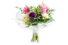 Bouquet In Cellophane With Pink And Purple Flowers, Isolated On Royalty Free Stock Photography