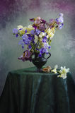 Bouquet of irises. Bouquet of colorful irises in a vase on a table Royalty Free Stock Photos
