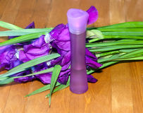 Bouquet of irises and cosmetic  bottle Stock Image