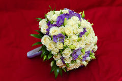 A bouquet isolated on red background Stock Photos