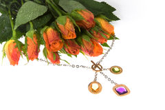 Bouquet  and a jeweller ornament Royalty Free Stock Photography