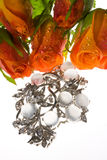 Bouquet  and a jeweller ornament Royalty Free Stock Photos