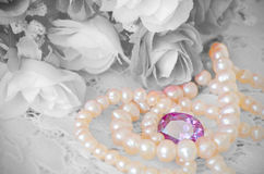 Bouquet, Jewelry and Pearls Necklace. Royalty Free Stock Photography