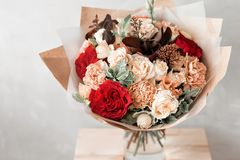 Bouquet in kraft paper. A simple bouquet of flowers and greens Royalty Free Stock Photos