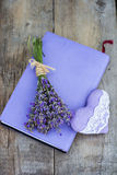 Bouquet of lavender. And diary on the old table Royalty Free Stock Image