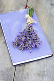 Bouquet of lavender and diary. On the old table Royalty Free Stock Photo