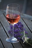 Bouquet of lavender and glass of wine Royalty Free Stock Images