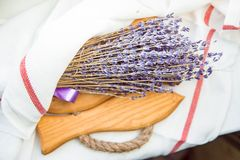 Bouquet of lavender on wooden base on white towel. Bouquet of lavender on a wooden base on a white towel royalty free stock photos