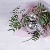 Bouquet of leaves and kitchen utensils.  gift-wrapped tools. concept of sexism and feminism, patriarchal society and gender royalty free stock images
