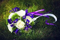 Bouquet lies on the green grass Royalty Free Stock Image