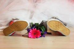 Bouquet lies between legs of bride royalty free stock image