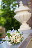 Bouquet lies on the marble railing. Wedding bouquet with white flowers with gold lying on the marble railing Royalty Free Stock Photos