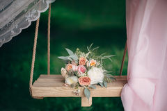 Bouquet lies on a swing. Wedding decorations Stock Photography