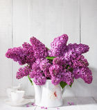 Bouquet of lilac  and cup of coffee. Royalty Free Stock Image