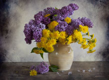 Bouquet of lilac and dandelions Royalty Free Stock Image