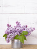 Bouquet of lilac flowers on white wooden background Stock Images