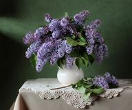 Bouquet of lilac on the table. Bouquet of lilac in a jug on the table. Still life with flowers Stock Photo