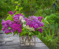 Bouquet of lilac on the table in the garden Stock Photo