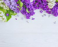 Bouquet of lilac on wooden background frame stock photos