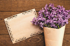 Bouquet of lilacs with an inscription card stock photo