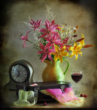 Bouquet of lilies and old suitcase Stock Images