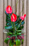 Bouquet from lily. On background of sackcloth Stock Photo