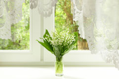 Bouquet of lily of the valley. On the windowsill Stock Images