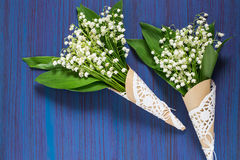 Bouquet of lily of the valley on blue background Royalty Free Stock Image