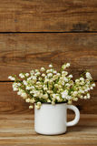 Bouquet of lily of the valley in the mug Stock Photography