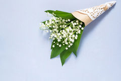 Bouquet of lily of the valley on pale blue background Stock Photography