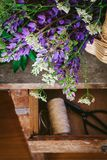 A bouquet of lupines and wild carrots on a vintage table, dark and moody style royalty free stock photo