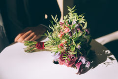 Bouquet lying on the table Royalty Free Stock Photos