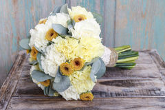 Bouquet made of yellow and white carnations stock photos