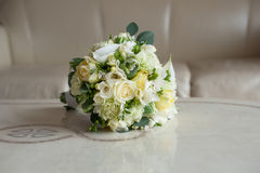 Bouquet on a marble table. Bridal bouquet on a marble wihte table Royalty Free Stock Images