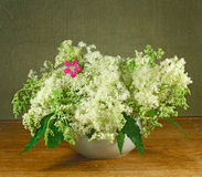 Bouquet of meadow flowers on a wooden table Stock Photos