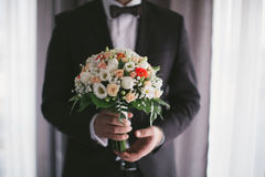 Bouquet in the men hands Royalty Free Stock Photography