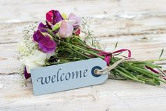 Bouquet with message welcome stock photos