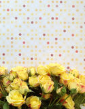 Fresh yellow roses and polka dots vertical Stock Image
