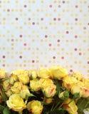 Fresh yellow roses and polka dots vertical Stock Image
