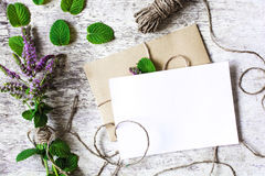 Bouquet of mint wildflowers and blank white greeting card Royalty Free Stock Photo
