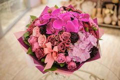 Bouquet of mixed pink and purple flowers with huge orchids Royalty Free Stock Image