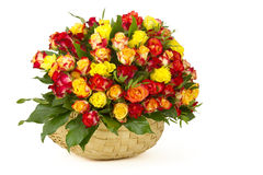 A bouquet of multicolored roses in a basket Royalty Free Stock Photos