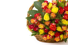 A bouquet of multicolored roses in a basket Stock Photo