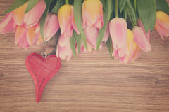 Bouquet of multicolored   tulip flowers with heart Royalty Free Stock Photo