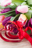 Bouquet of multicolored   tulip flowers with heart Stock Photography