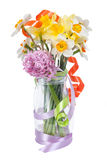 Bouquet of narcissus and pink hyacinth in vase with Royalty Free Stock Photography