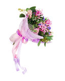 Bouquet of nerine, hyacinth, statice and other flowers. Delicate beautiful bouquet of nerine, hyacinth, statice and other flowers in pink packaging with tape Royalty Free Stock Image